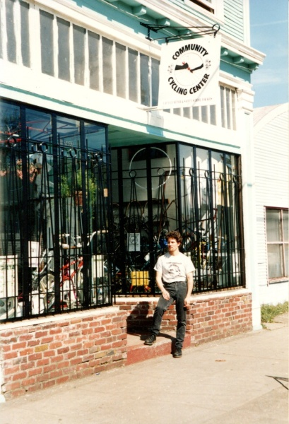 Founder Brian Lacy with original logo and bike shop location on 24th and Alberta