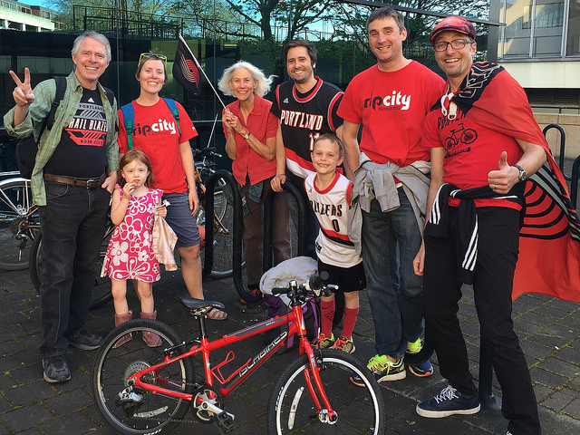 Blazer fans on bike at recent Bike to Blazers event.