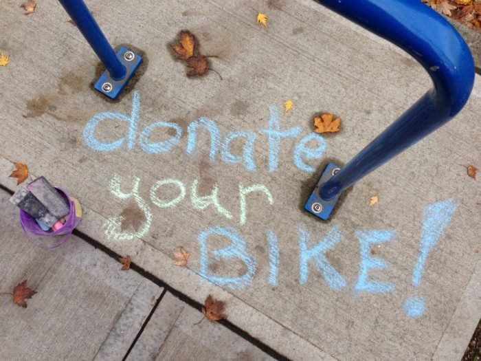 """Donate your bike"" in sidewalk chalk"