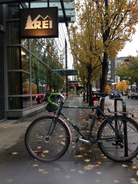 Bike in front of REI sign