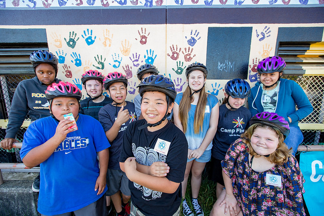 Bike campers with helmets smiling